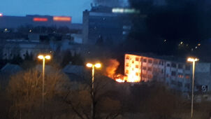 Clouds of smoke and flames visible from afar. Fire in Lodz